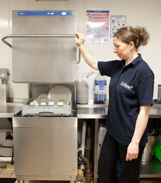 Kitchen cleaner emptying dishwasher